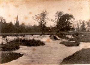 Picture of The River Culm after heavy rain.  Taken from the Park, Uffculme, devon.  Undated.